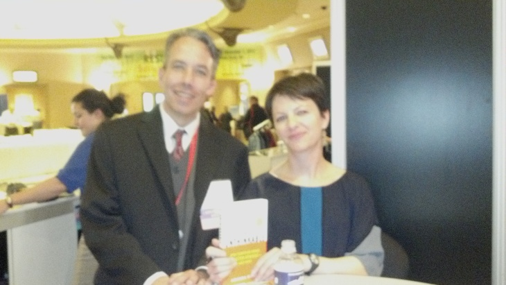 "Getting my photo taken at book signing with Amanda Ripley, author of ""The Unthinkable"" at IAEM 2011"